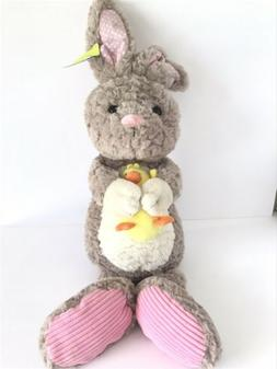 brown and pink easter bunny holding yellow