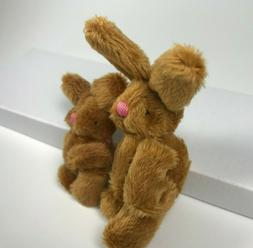 two brown stuffed bunny rabbits easter bunny